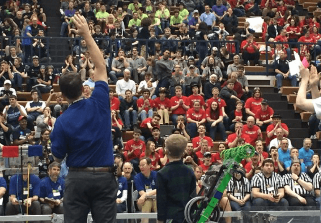 Andrew Dill pumping up the crowd at the FIRST Competition